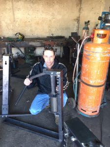 Kobus Venter, Director at Vuthisa with one of the Ratchet Presses ready for shipment.